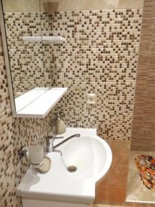 Ванная комната в ASTA Apartments