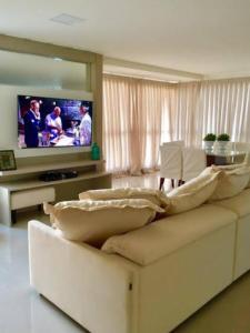 A bed or beds in a room at Apto em B. Camboriú Praia e Mar