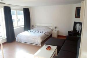 Un ou plusieurs lits dans un hébergement de l'établissement The coolest baby penthouse in Oostende