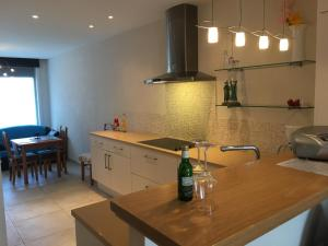 A kitchen or kitchenette at Deluxe Apartment with Shared Pool