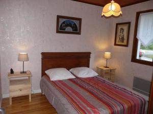 Un ou plusieurs lits dans un hébergement de l'établissement Chalet Roche Rousse