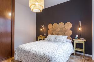 Ein Bett oder Betten in einem Zimmer der Unterkunft Luminoso Apartamento El Rastro