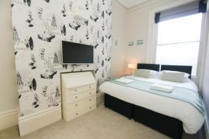 Ein Bett oder Betten in einem Zimmer der Unterkunft Sea View Parade