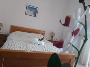 A bed or beds in a room at Posidonia Pension