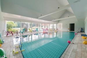 Het zwembad bij of vlak bij Villa Kempen-Broek