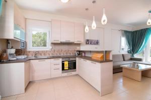 A kitchen or kitchenette at Olive Garden Villas