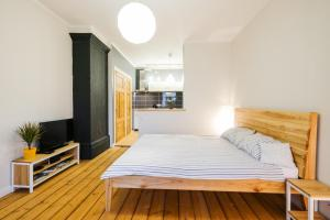 A bed or beds in a room at Cesis Old city Apartment