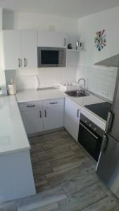 A kitchen or kitchenette at Lovely Apartment