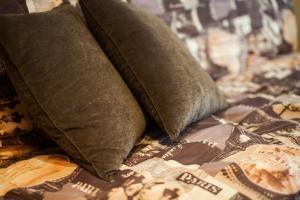 Кровать или кровати в номере Apartment, Mayskaya, 24