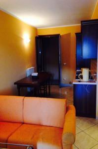 TV a/nebo společenská místnost v ubytování Residence La Sorgente