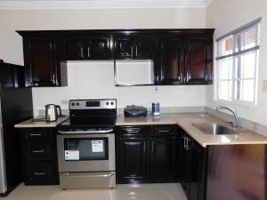 A kitchen or kitchenette at A Little Gem