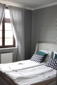 Voodi või voodid majutusasutuse Apartament Nad Jeziorem Dlugim toas
