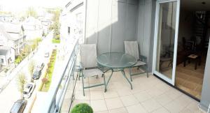 A balcony or terrace at Apartament w Villa Marea