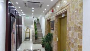 The lobby or reception area at Oman Palm Hotel Suites