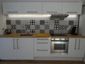 A kitchen or kitchenette at Villa Colonna Appartements
