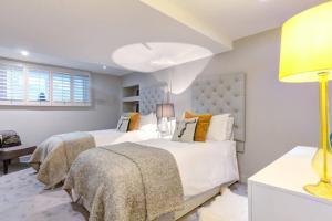 Posteľ alebo postele v izbe v ubytovaní The Greyfriars Apartment