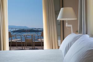 Ένα ή περισσότερα κρεβάτια σε δωμάτιο στο Celestia Villas