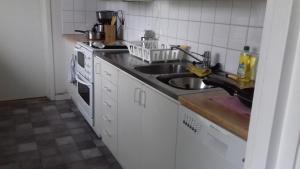 A kitchen or kitchenette at Holiday Home Byvägen 38
