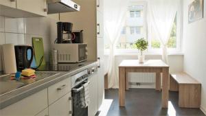 A kitchen or kitchenette at Apartment Furstenberger Strasse