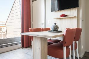 Een TV en/of entertainmentcenter bij Holiday Suites Westende