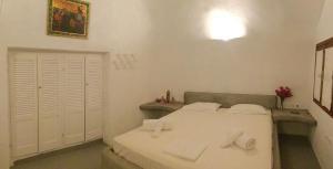 Un ou plusieurs lits dans un hébergement de l'établissement Tzannis Cave House
