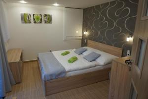 Postel nebo postele na pokoji v ubytování Apartmán Štěpánka