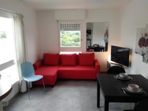 Coin salon dans l'établissement Appartement 2 pièces avec grande terrasse