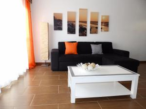 A seating area at Apartamento Boheme