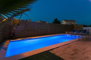 The swimming pool at or near Villa JASMINA