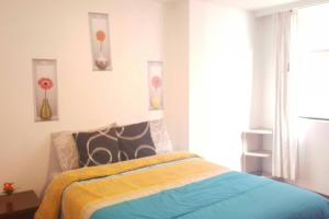 A bed or beds in a room at 2BR*BEST AREA*24/7 SECURITY