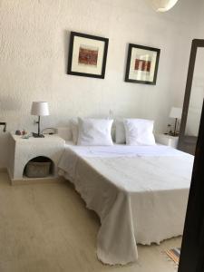 Ένα ή περισσότερα κρεβάτια σε δωμάτιο στο Elea Apartment