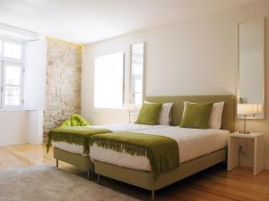 A bed or beds in a room at PWHC Miragaia Apartments
