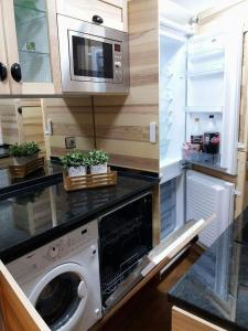A kitchen or kitchenette at Best house airport lisbon