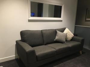 A seating area at Collins Street Apartments
