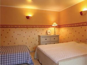 Un ou plusieurs lits dans un hébergement de l'établissement Five-Bedroom Holiday Home in Annonay