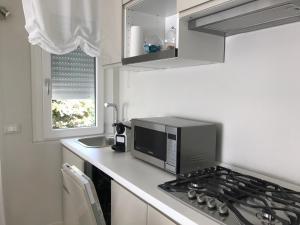 A kitchen or kitchenette at via trento
