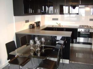 A kitchen or kitchenette at Center Apartment