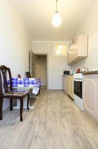 Кухня или мини-кухня в Apartment on Ploshchad Lenina 12/2
