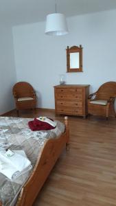 A bed or beds in a room at Ferienwohnung am Theo Carlen Platz