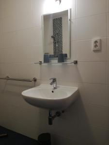 Een badkamer bij Stal Zwartschaap