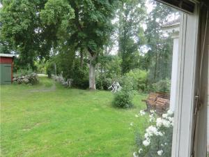 En trädgård utanför Holiday home Yxnarydsvägen Sölvesborg