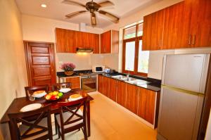 A kitchen or kitchenette at The Haven Pool Villa