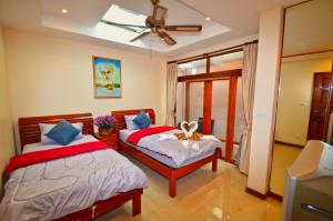A bed or beds in a room at The Haven Pool Villa