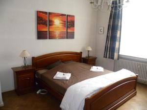 A bed or beds in a room at City Apartment Oostende Zeedijk