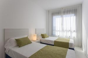 A bed or beds in a room at Pierre & Vacances Torredembarra