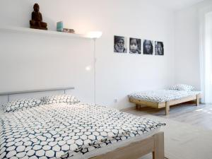 A bed or beds in a room at Apartment Na Šanci