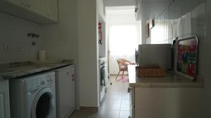 A kitchen or kitchenette at Silver Light - Touristic Apartments