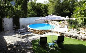 The swimming pool at or near Holiday home Serenity