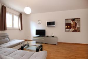 Ein Sitzbereich in der Unterkunft Apartments My Place