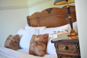 A bed or beds in a room at The Ickworth Hotel And Apartments- A Luxury Family Hotel